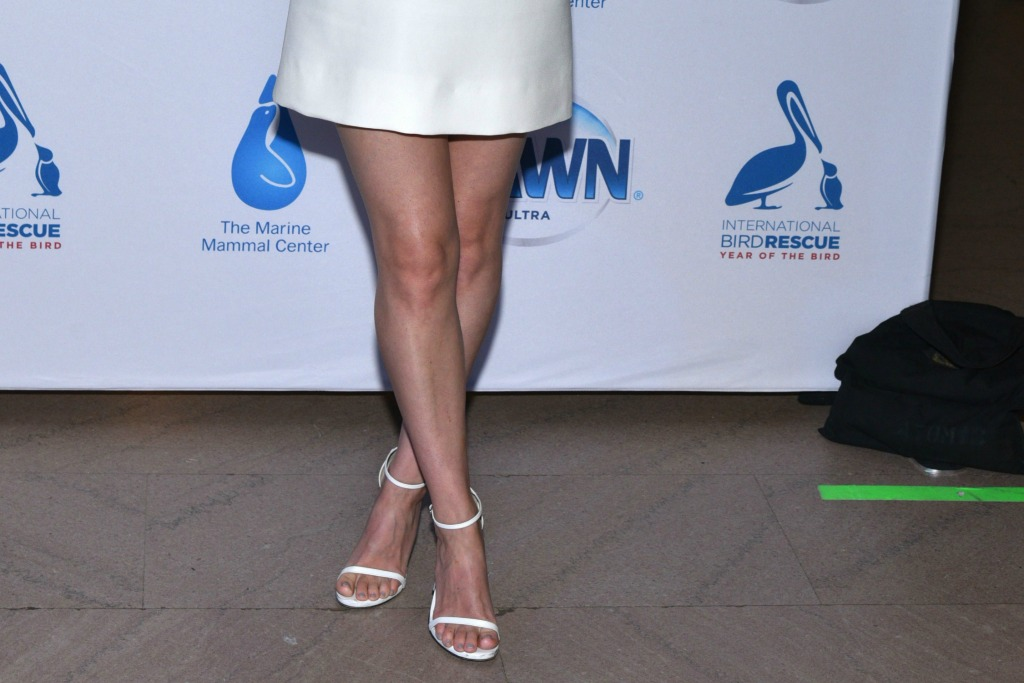 Kate Mara slips on fresh white sandals for Dawn anniversary event in the Big Apple.