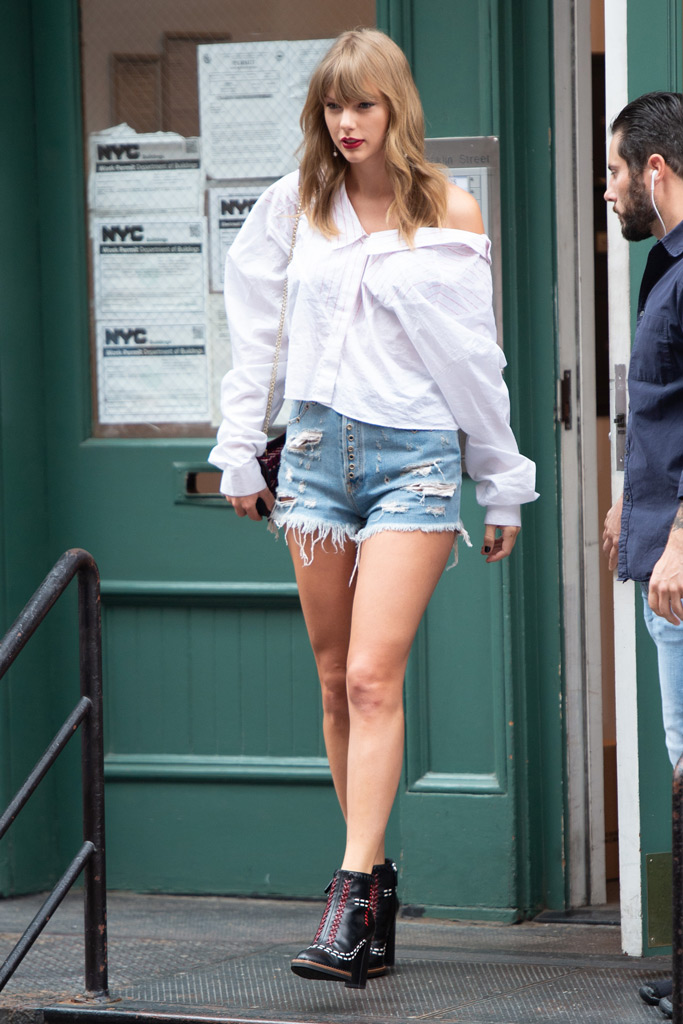 Taylor Swift, ankle boots, denim shorts