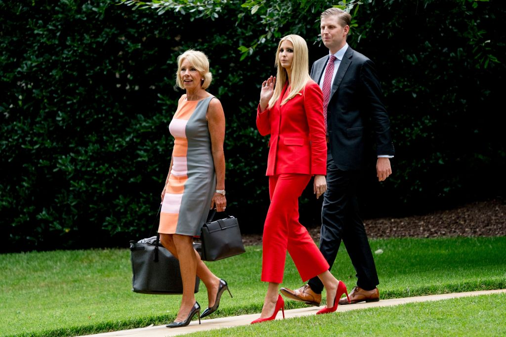 sandro red suit, vanka Trump, Betsy DeVos, Eric Trump. Ivanka Trump, cdenter, the daughter of President Donald Trump, Education Secretary Betsy DeVos, left, and Eric Trump, the son of President Donald Trump, walk towards Marine One at the White House in Washington, for a short trip to Andrews Air Force Base, Md., and then on to Tampa, Fla. to accompany President Donald Trump to a rallyTrump, Washington, USA - 31 Jul 2018
