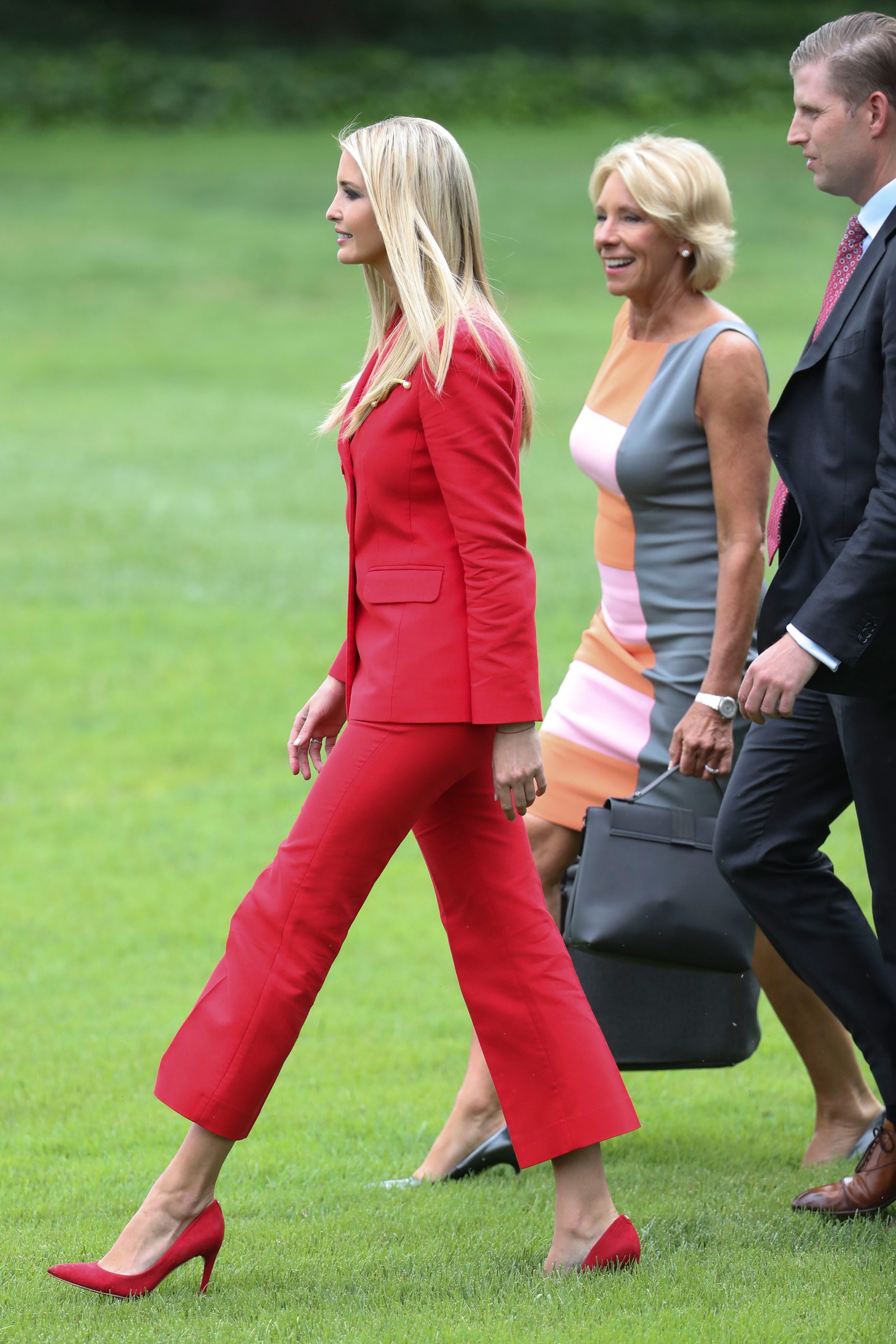 sandro red suit, Ivanka Trump (L), US Secretary of Education Betsy DeVos (C) and Eric Trump (R) walk to board Marine One on the South Lawn of the White House in Washington, DC, USA, 31 July 2018. Today jury selection begins for Paul Manafort's trial in Alexandria federal court on bank and tax fraud charges discovered during the special counsel's investigation of Russian meddling in the 2016 presidential election.US President Donald J. Trump departs the White House for an evening trip to Tampa, Florida, Washington, USA - 31 Jul 2018WEARING SANDRO
