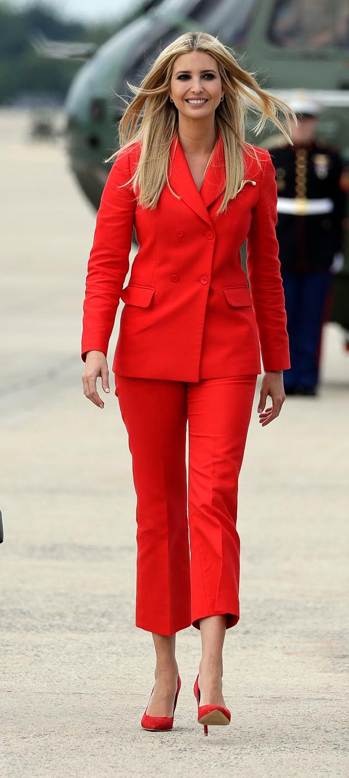 red sandro suit, Ivanka Trump, the daughter of President Donald Trump, center, walks with Education Secretary Betsy DeVos, left, and Eric Trump, son of President Donald Trump, as they walk to board Air Force One with President Donald Trump for a trip to Tampa, Fla., to attend a campaign rally, in Andrews Air Force Base, MdTrump, Andrews Air Force Base, USA - 31 Jul 2018