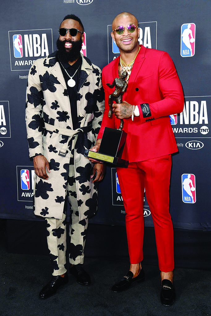 NBA player James Harden, of the Houston Rockets, left, winner of the most valuable player award, poses in the press room with his teammate P.J. Tucker at the NBA Awards, at the Barker Hangar in Santa Monica, Calif2018 NBA Awards - Press Room, Santa Monica, USA - 25 Jun 2018