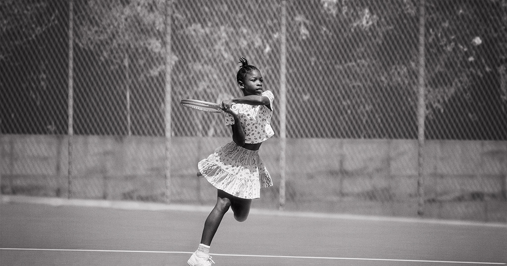 1992: Serena Williams in action on the tennis court.