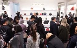 Shoppers make purchases inside Selfridges as