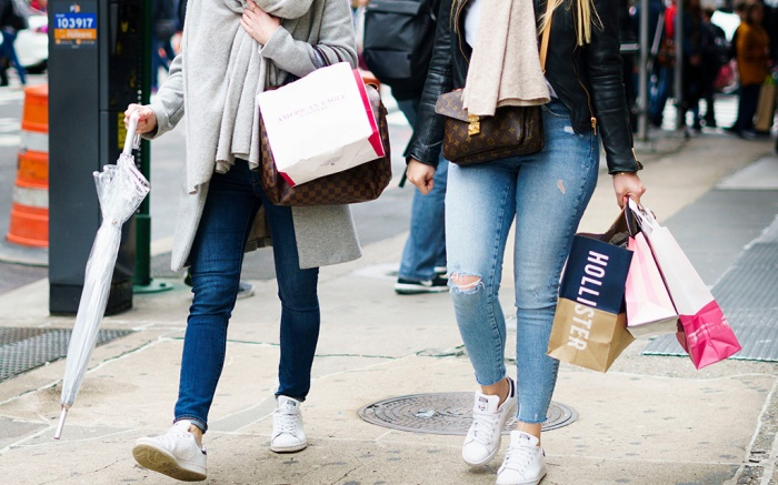 People carry shopping bags in New York