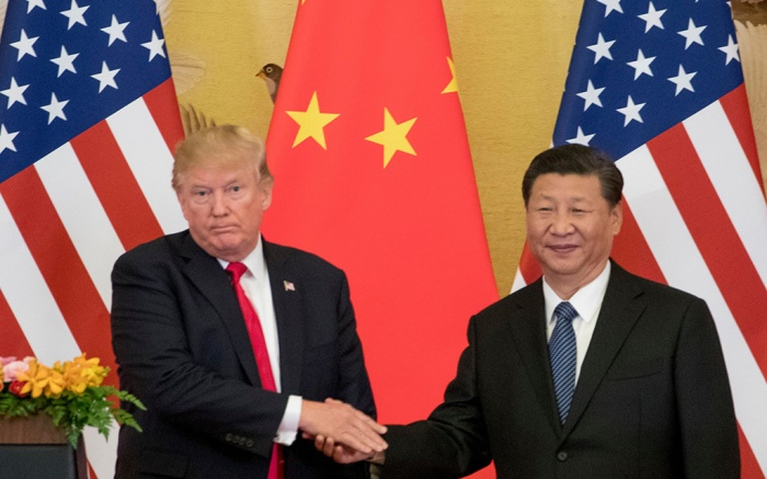 """Donald Trump, Xi Jinping. President Donald Trump and Chinese President Xi Jinping shake hands during a joint statement to members of the media Great Hall of the People in Beijing, China. The U.S. is announcing that it will impose a 25 percent tariff on $50 billion worth of Chinese goods containing """"industrially significant technology."""" The White House said, that the tariff will cover goods related to the """"Made in China 2025"""" program. The full list of imports that will be covered will be announced by June 15Trade, Beijing, China - 09 Nov 2017"""