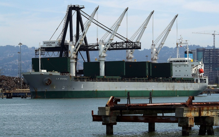 A ship is loaded with scrap metal by Schnitzer Steel at the Port of Oakland, in Oakland, CalifContainer Shipping Trade Tariffs, Oakland, USA - 12 Jul 2018