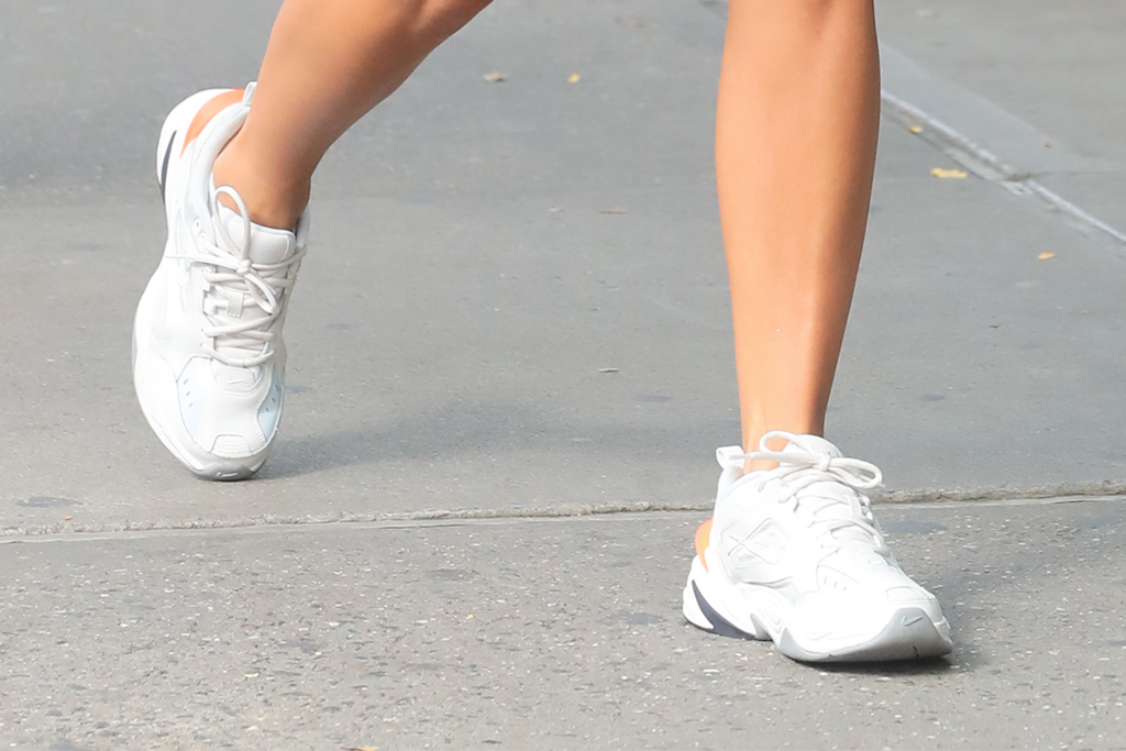 rita ora, white nike sneakers