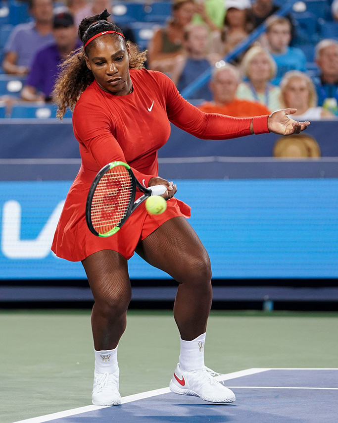 Serena Williams returns to Petra Kvitova, of the Czech Republic, at the Western & Southern Open tennis tournament, in Mason, OhioCincinnati Tennis, Mason, USA - 14 Aug 2018