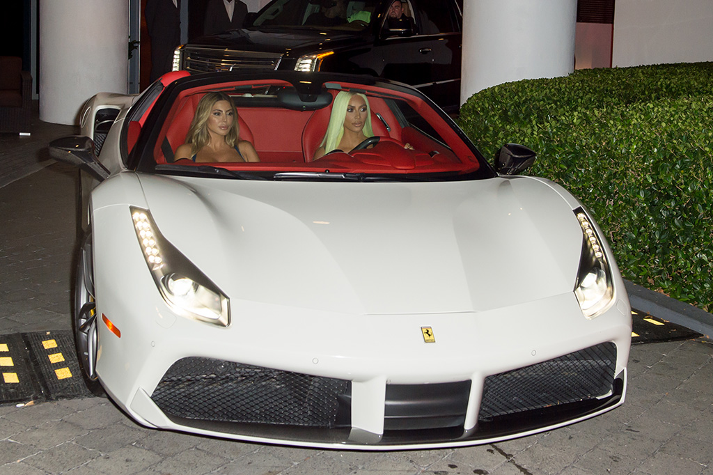 Headturner Kim Kardashian sports long neon green tresses as she and pal Larsa Pippen drive through Miami Beach in a white Ferrari before swapping the car for a green Lamborghini, on Thursday (august 16). The reality TV megastar showed off her famous curves in a skintight metallic minidress as she left her upscale hotel to have dinner at celebrity hotspot Prime 112 restaurant on Ocean Drive before getting into a green Lamborghini and driving off to Story night club in South Beach.Pictured: Kim KardashianRef: SPL5016676 160818 NON-EXCLUSIVEPicture by: AM / SplashNews.comSplash News and PicturesLos Angeles: 310-821-2666New York: 212-619-2666London: 0207 644 7656Milan: +39 02 4399 8577Sydney: +61 02 9240 7700photodesk@splashnews.comWorld Rights