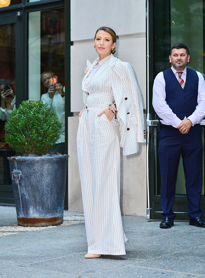 Blake Lively looks striking in a matching white pinstripe suit with lace underneath as she poses for fans after finishing her press junket in New York, NY.Pictured: Blake LivelyRef: SPL5017183 200818 NON-EXCLUSIVEPicture by: SplashNews.comSplash News and PicturesLos Angeles: 310-821-2666New York: 212-619-2666London: 0207 644 7656Milan: +39 02 4399 8577Sydney: +61 02 9240 7700photodesk@splashnews.comWorld Rights
