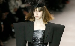 A model wears a creation for