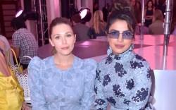 Elizabeth Olsen (L) and Priyanka Chopra,