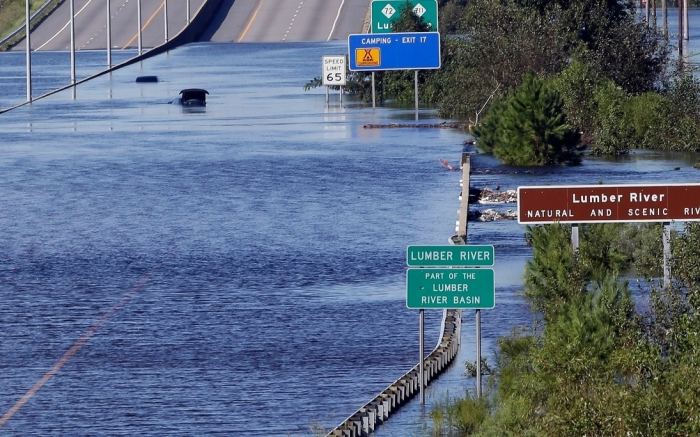 The Lumber River overflows onto a stretch Interstate 95 in Lumberton, N.C., following flooding from Hurricane FlorenceTropical Weather North Carolina, Lumberton, USA - 18 Sep 2018