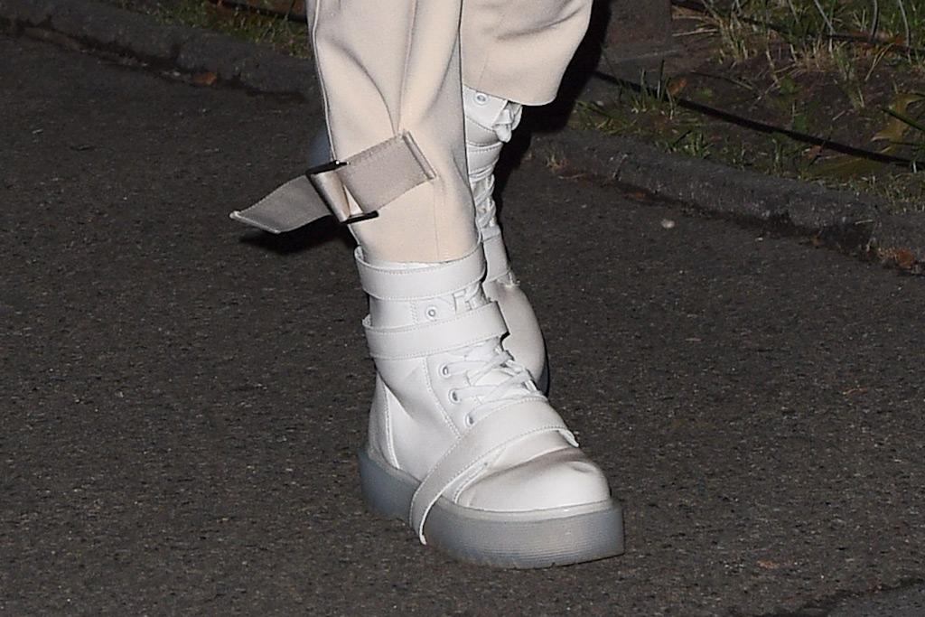 Gigi Hadid, white boots, backstage