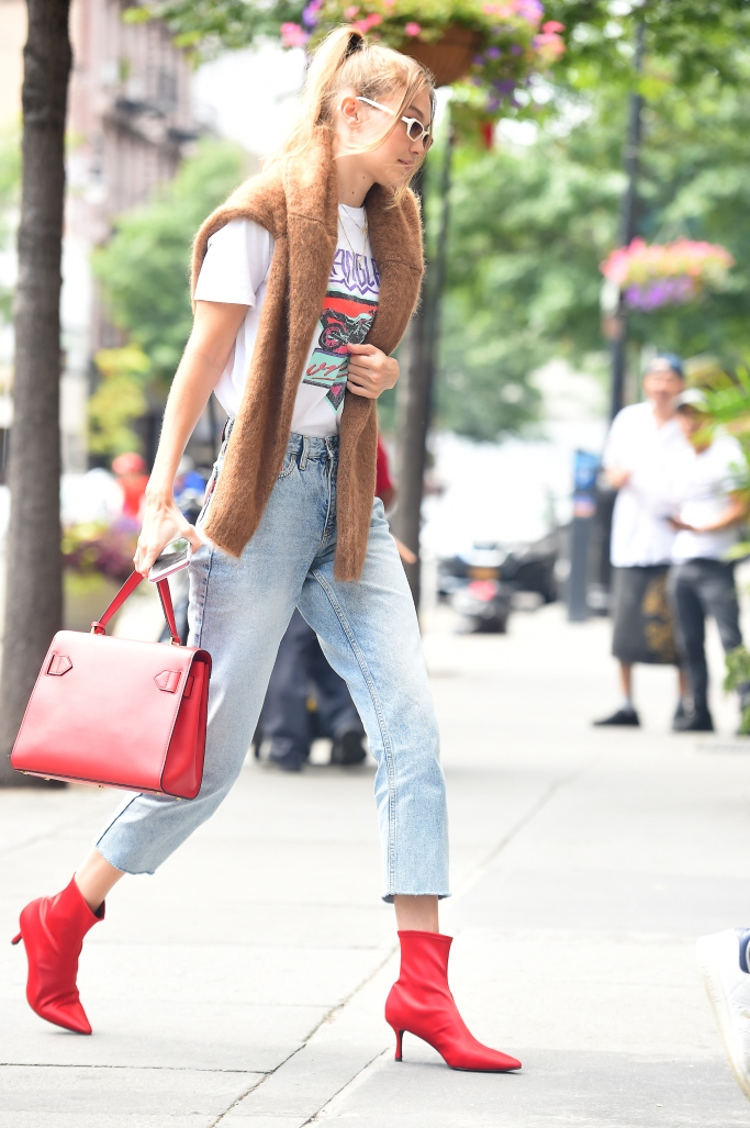 gigi hadid street style, red boots, red bag