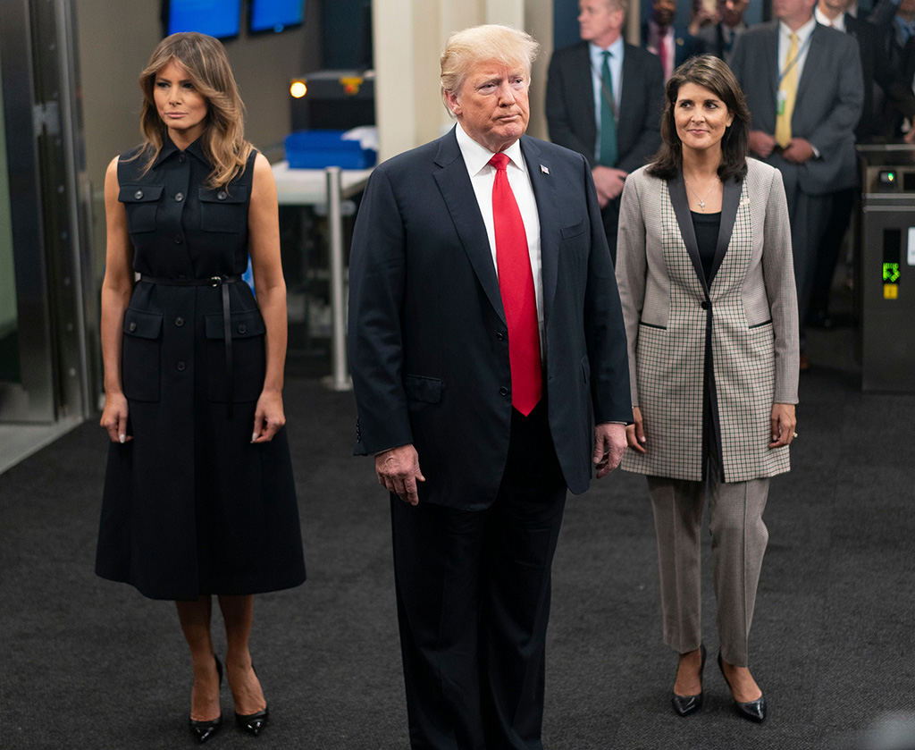 President Donald Trump addresses members of the news media as he arrives with First lady Melania Trump, left, and Nikki Haley, the U.S. ambassador to the United Nations, during the 73rd session of the United Nations General Assembly, at U.N. headquartersUN Trump - 25 Sep 2018