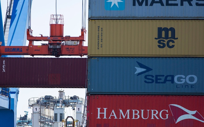 Shipping containers are loaded on and off at cargo ship at the Conley Shipping Terminal in Boston, Massachusetts, USA 10 July 2018. On 06 July 2018, the Trump Administration imposed a 25 percent tariff on 34 billion US dollars of Chinese imported goods, drawing a response from China with a tariff on US goods imported into China.Shipping Containers on a cargo ship in Boston, USA - 10 Jul 2018