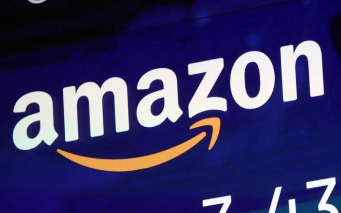The logo for Amazon is displayed on a screen at the Nasdaq MarketSiteFinancial Markets Wall Street Amazon, New York, USA - 27 Jul 2018