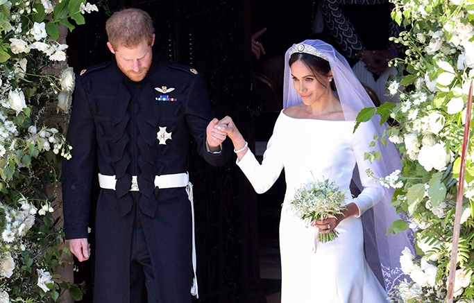 Prince Harry and Meghan Markle leave after their wedding ceremony at St. George's Chapel in Windsor Castle.