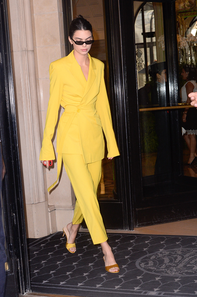 Kendall Jenner is seen exiting her hotel wearing a yellow suit in Paris, France.Pictured: Kendall JennerRef: SPL5027749 260918 NON-EXCLUSIVEPicture by: Julien Reynaud/APS-Medias/ABACAPRESS.COM / SplashNews.comSplash News and PicturesLos Angeles: 310-821-2666New York: 212-619-2666London: 0207 644 7656Milan: +39 02 4399 8577Sydney: +61 02 9240 7700photodesk@splashnews.comAustralia Rights, New Zealand Rights, United Kingdom Rights, United States of America Rights