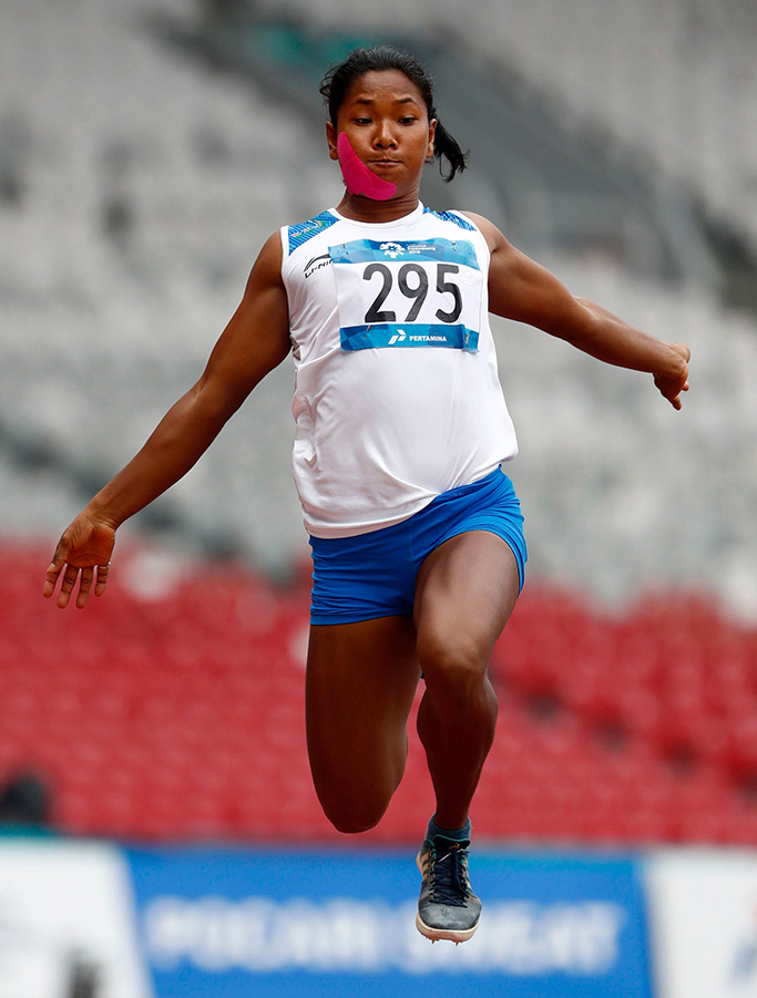 India's Swapna Barman competes in the heptathlon long jump during the athletics competition at the 18th Asian Games in Jakarta, IndonesiaAsian Games Athletics, Jakarta, Indonesia - 29 Aug 2018