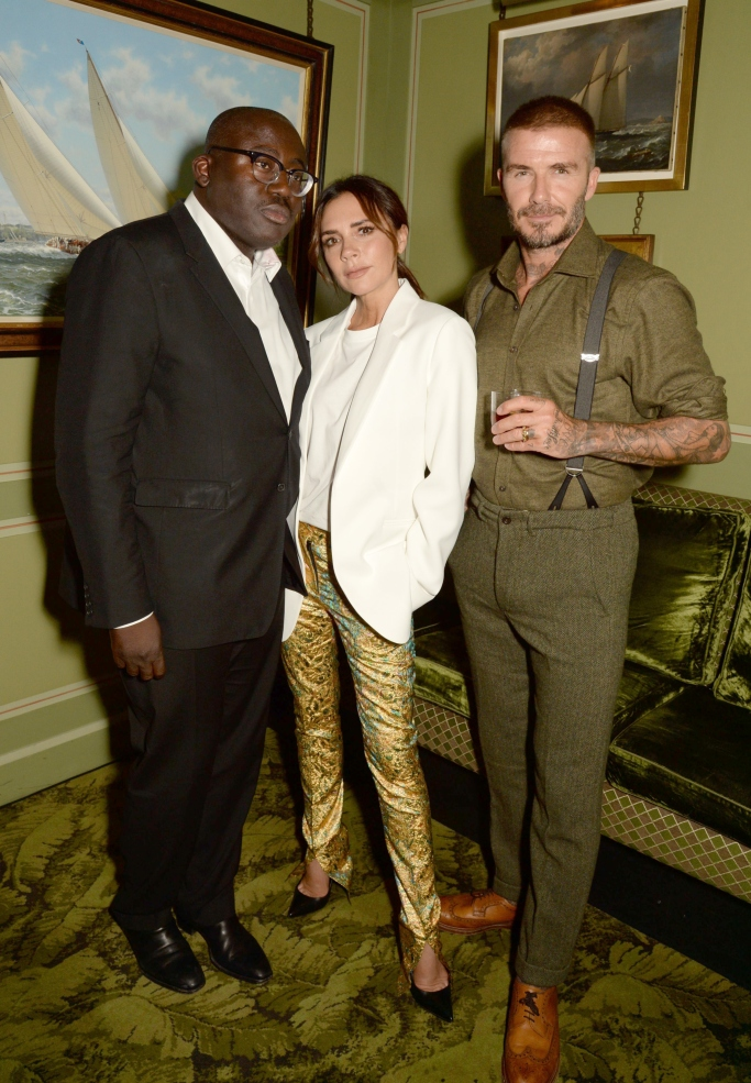Edward Enninful poses with Victoria Beckham and David Beckham