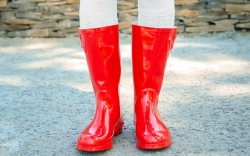 Young woman in red wellington boots