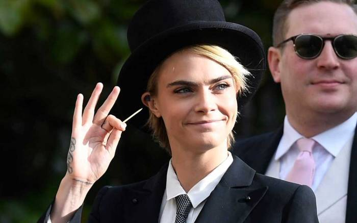 Cara Delevingne at Princess Eugenie's wedding in Emporio Armani.