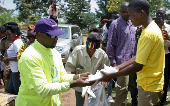 Kanye West handing out Yeezys in Uganda