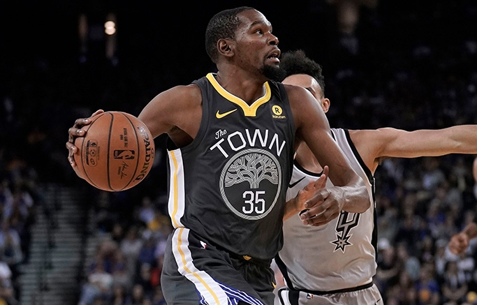 Kevin Durant and Derrick WhiteSan Antonio Spurs at Golden State Warriors, Oakland, USA - 10 Feb 2018Golden State Warriors forward Kevin Durant (L) drives to the basket as San Antonio Spurs guard Derrick White (R) defends during the first half of their NBA game at Oracle Arena in Oakland, California, USA, 10 February 2018.