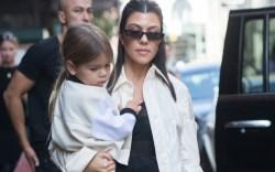 Kourtney Kardashian toting her youngest son,