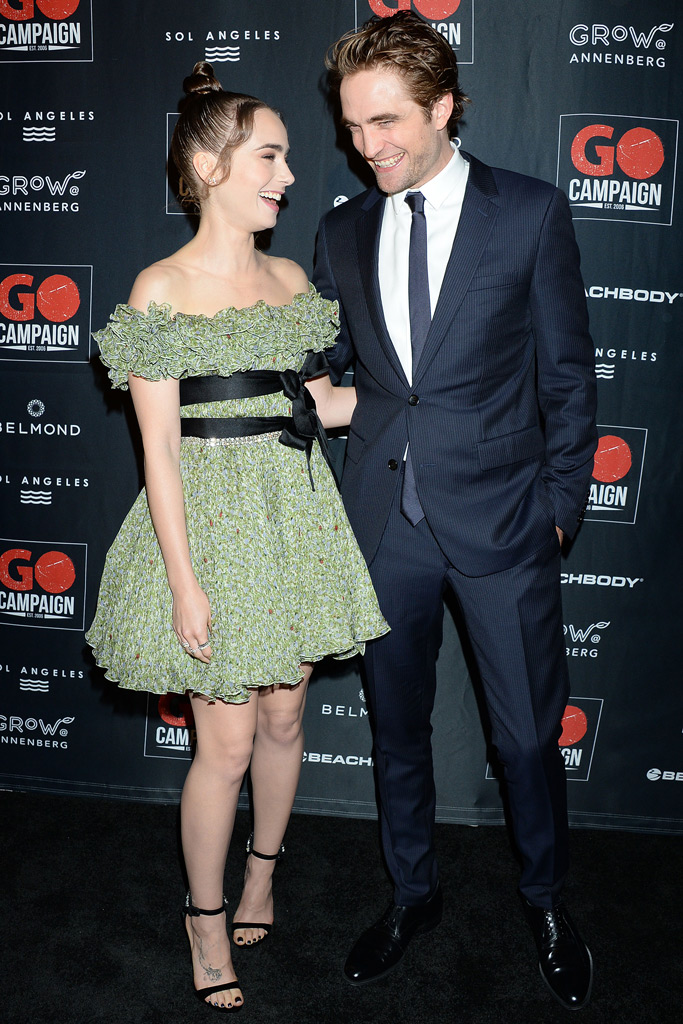Lily Collins and Robert Pattinson, red carpet, laughing, go campaign gala