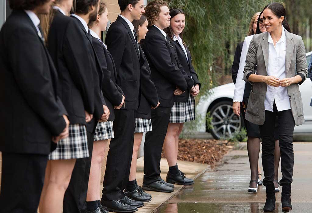 Megan Markle visits a school.