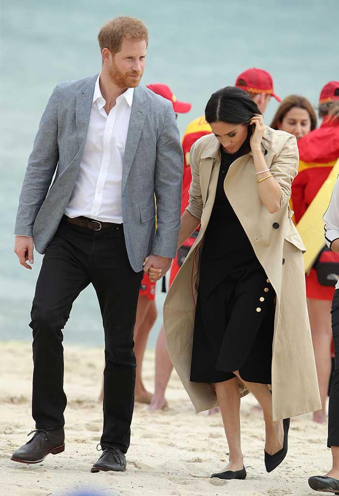 Meghan Markle and Prince Harry on the beach in Australia.