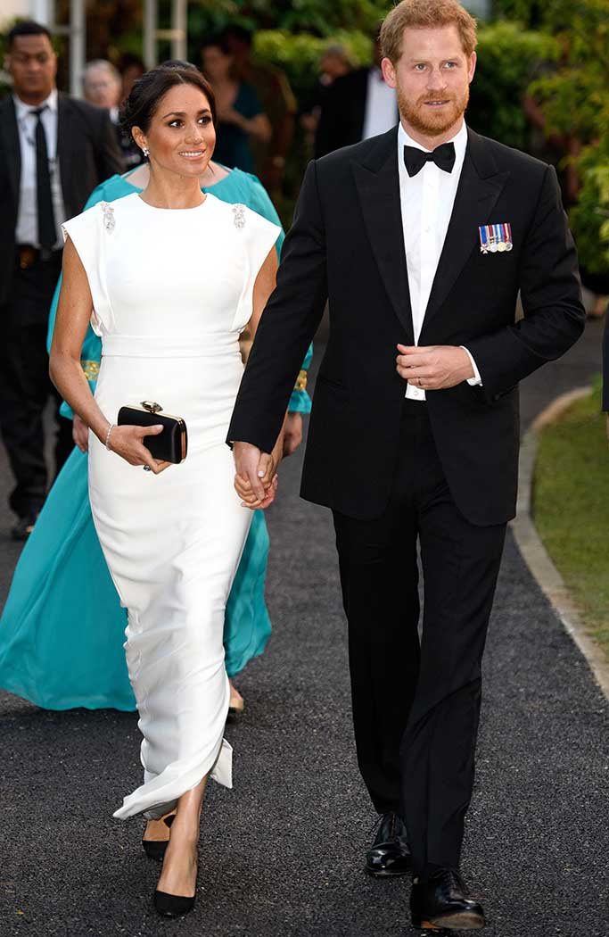 Meghan Markle wearing Theia Couture and Tabitha Simmons pumps.