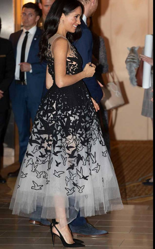 Meghan Markle wears Oscar de la Renta and Aquazzura.