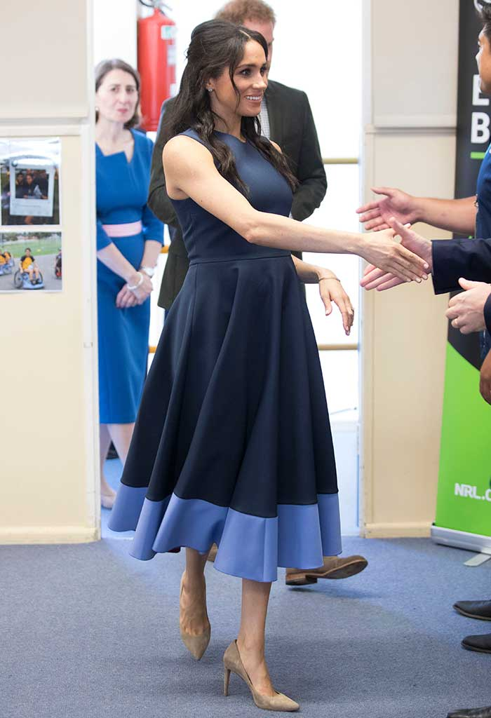Meghan Markle wore Roksanda Ilincic on day 5 of the royal tour, teaming her look with shoes by Stuart Weitzman.