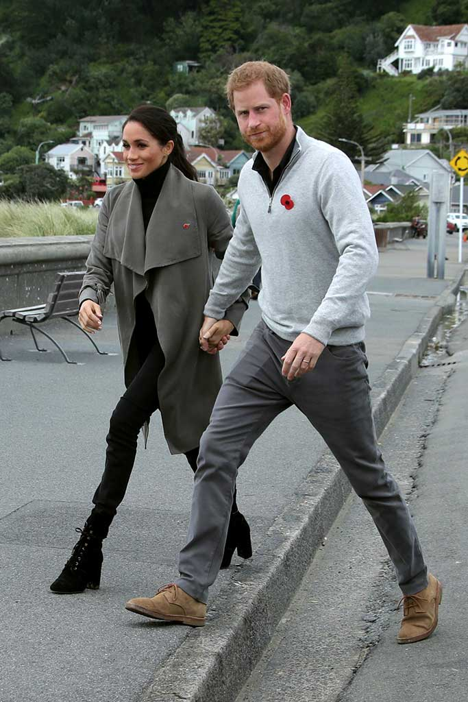 Meghan Markle and Prince Harry in New Zealand. Markle wears Stuart Weitzman boots.