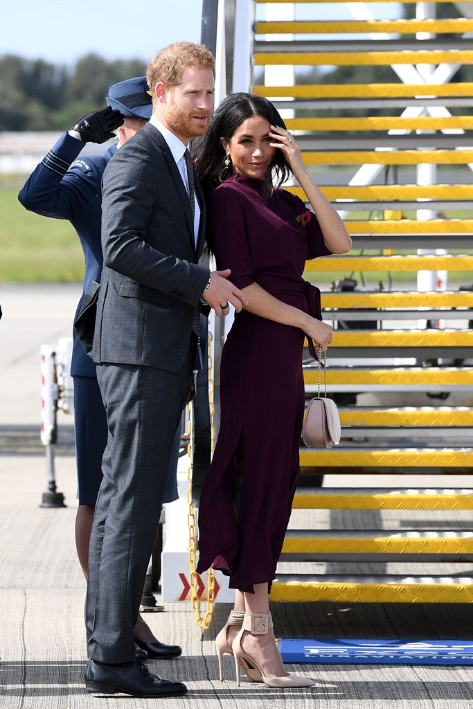 Meghan Markle wears a Boss by Hugo Boss dress and Aquazzura Casablanca pumps.