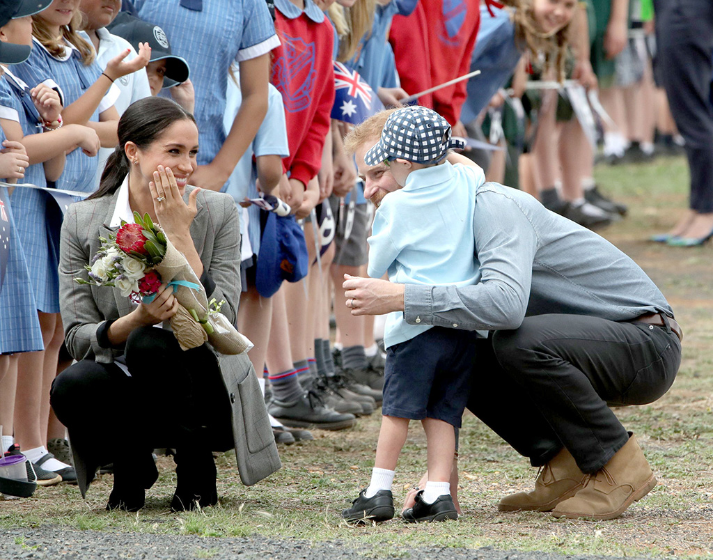 j crew boots, serena williams collection jacket, Prince Harry and Meghan Duchess of Sussex, with Luke Vincent, aged 5 from Buninyong Public School, at Dubbo AirportPrince Harry and Meghan Duchess of Sussex tour of Australia - 17 Oct 2018