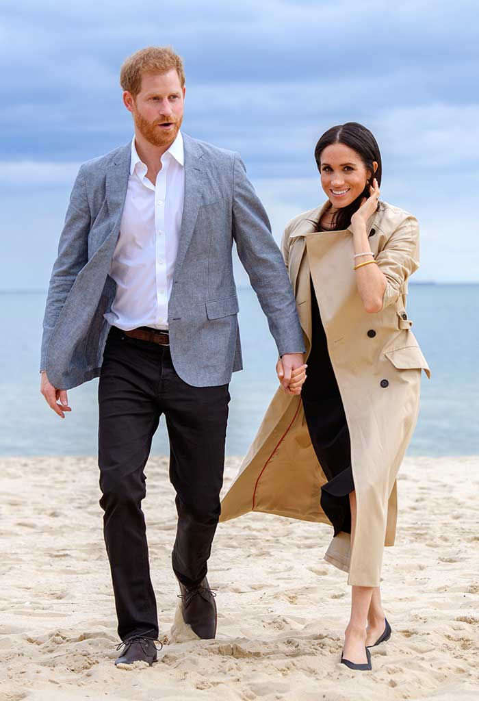 Meghan Markle and Prince Harry on the beach in Australia.