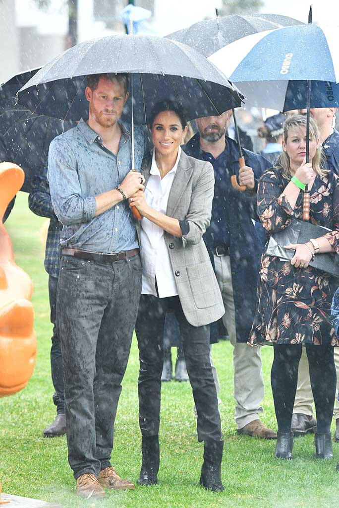 Megan and Harry in the rain.