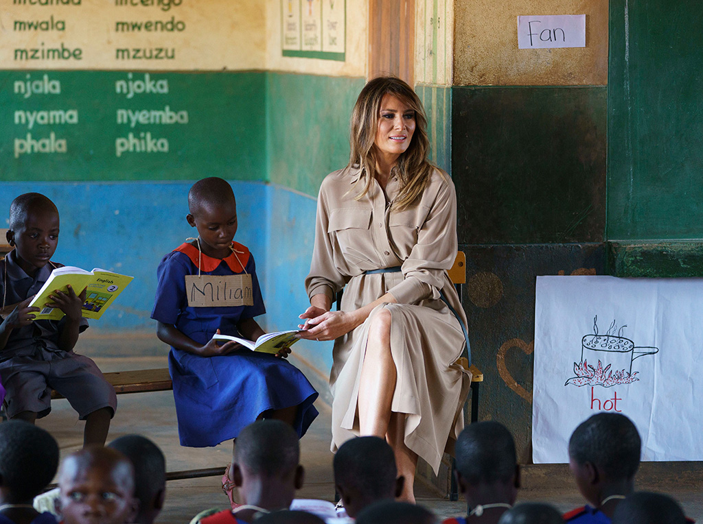 First lady Melania Trump helps a student as she visits a language class at Chipala Primary School, in Lilongwe, Malawi, . Mrs. Trump is visiting Africa on her first big solo international trip, aiming to make child well-being the focus of a five-day, four-country tourMelania Trump Africa, Lilongwe, Malawi - 04 Oct 2018