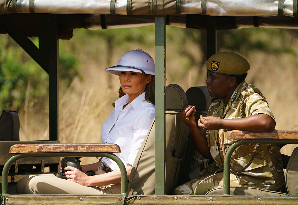 Melania Trump, pith helmet, Nelly Palmeris. First lady Melania Trump looks out over Nairobi National Park in Nairobi, Kenya, during a safari guided by Nelly Palmeris, right. Mrs. Trump is visiting Africa on her first big solo international tripMelania Trump Africa, Nairobi, Kenya - 05 Oct 2018