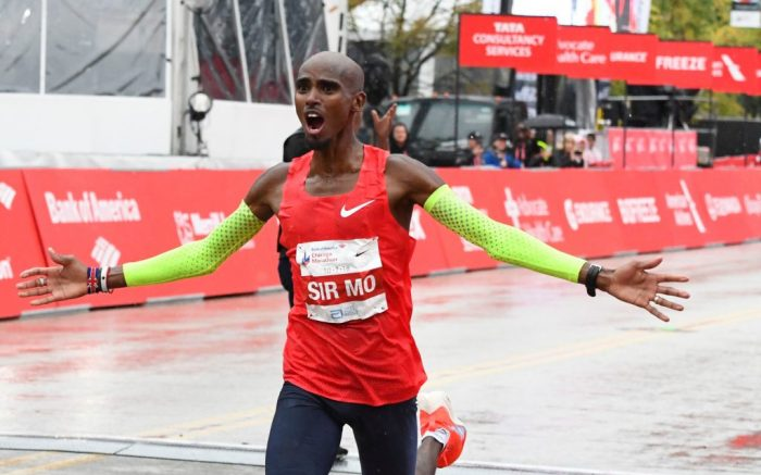 Mo Farah of Great Britain, raises his arm after he finishes in first place during the Bank of America Chicago Marathon, in ChicagoMarathon, Chicago, USA - 07 Oct 2018