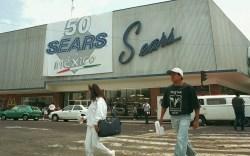 SEARS People walk by the Sears