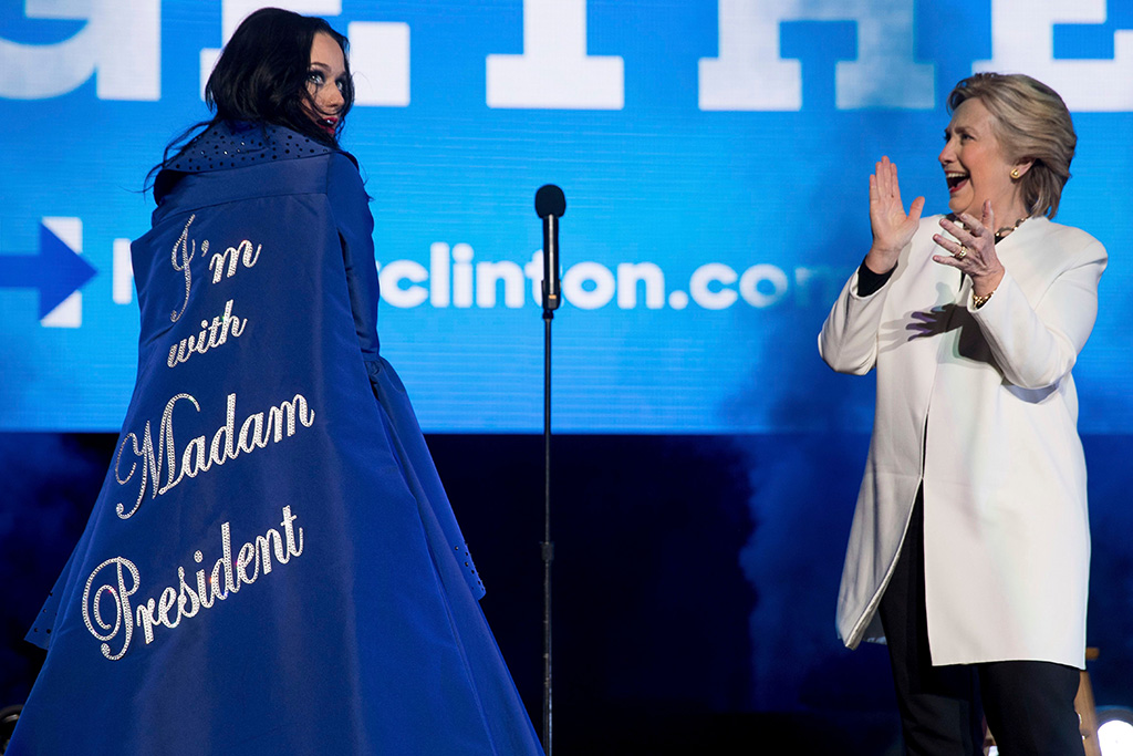 """Hillary Clinton, Katy Perry Democratic presidential candidate Hillary Clinton applauds on stage as artist Katy Perry arrives with a cape that reads """"I'm with Madam President"""" during a Get Out the Vote concert at the Mann Center for the Performing Arts in PhiladelphiaCampaign 2016 Clinton, Philadelphia, USA - 05 Nov 2016"""