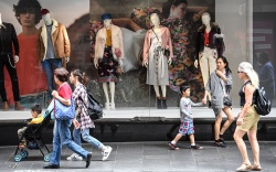 Retail shoppers are seen in Sydney,