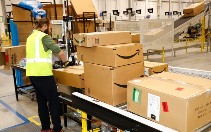 Amazon fulfillment center in Aurora, Colo. An associate checks labels on boxes during a tour of the Amazon fulfillment center, in Aurora, Colo. More than 1,000 full-time associates work in the Aurora facility, which opened in September 2017, and is one of more than 100 such fulfillment centers scattered across North AmericaAmazon Colorado - 03 May 2018